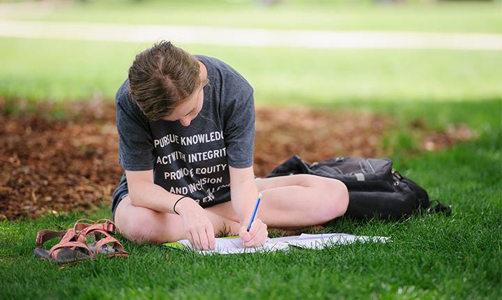Student studying on the Quad.